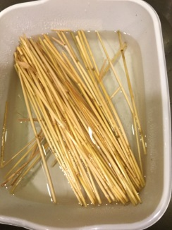 Place straw in dishpan of warm water.
